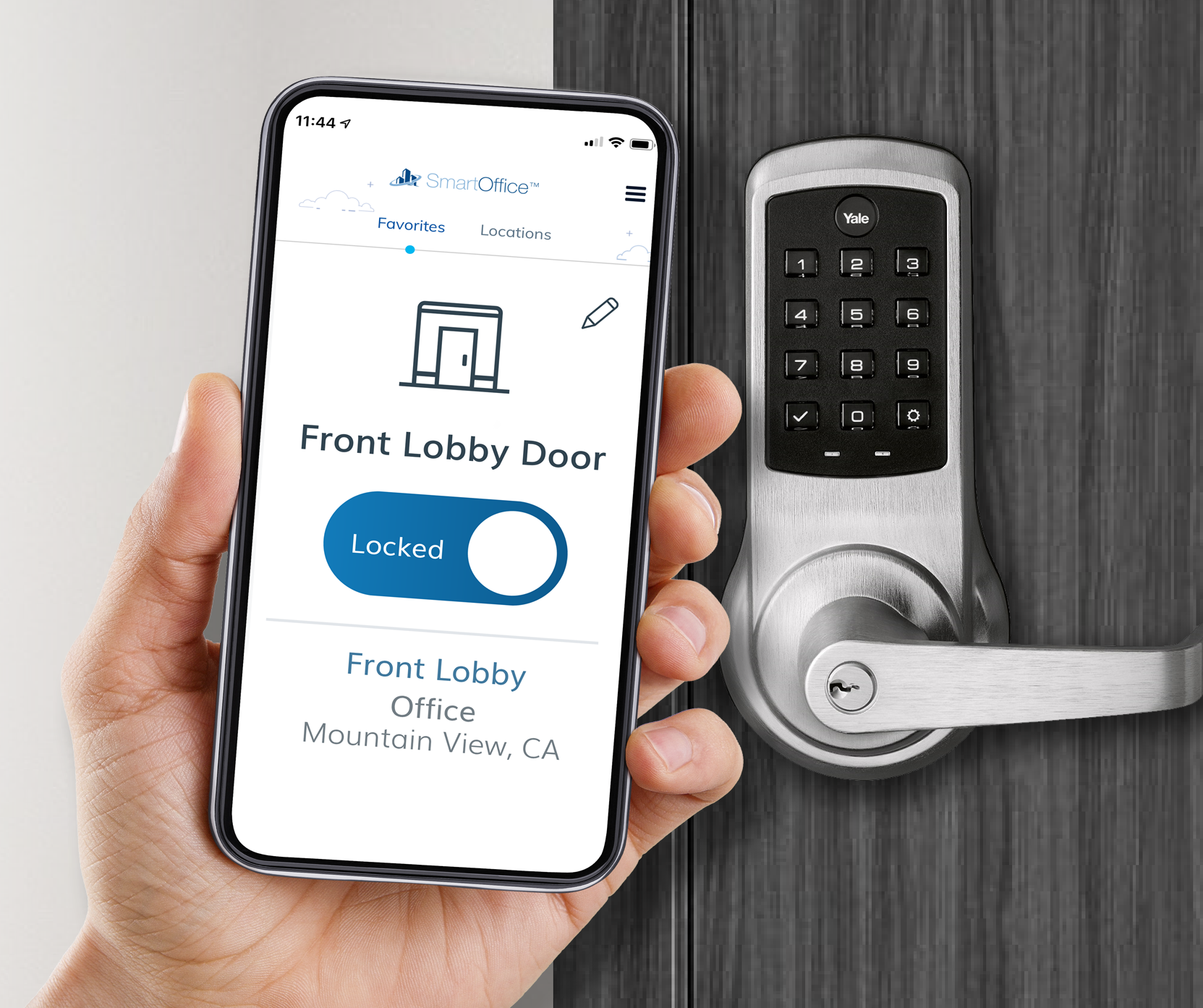 Hand holding a mobile phone with SmartOffice Access app in front of door with mag lock
